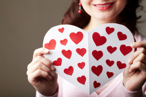 Close-up of female hands holding valentine card