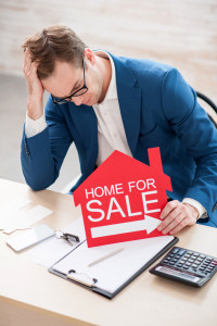 Estate agent is waiting for clients without results